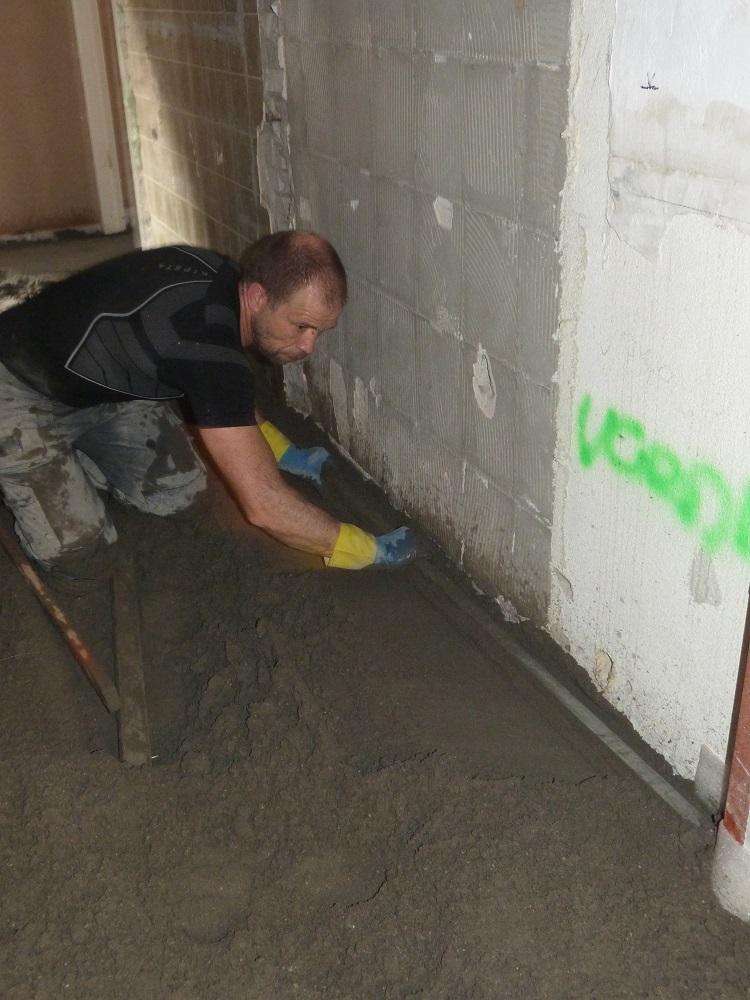 Leggen van een smeervloer of cementdekvloer